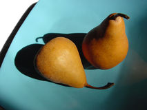 Pears. Two pears in a blue plate Royalty Free Stock Photo