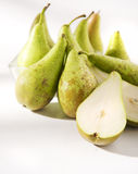 Pears. A cut pear in a group of wet pears stock images