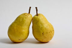 Pears. Two pearson white background with light shadows Royalty Free Stock Images