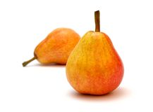 Pears. Two ripe red pears on the white background royalty free stock photo