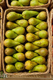 Pears. Ripe green pears of a grade in a basket Royalty Free Stock Photos