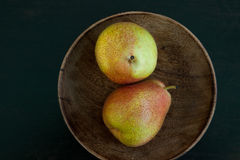 Pears. Top-view of a pair of pears in a wooden bowl Royalty Free Stock Photos