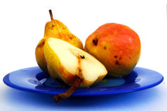 Pears. Three pears on a dark blue plate Royalty Free Stock Photography