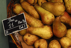 Pears. Basket full of fresh gold pears Royalty Free Stock Image