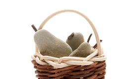 Pears. Made from pebbles and brown wicker basket Stock Photo