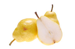 Pears. Whole and cut pears on white background royalty free stock photo
