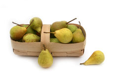 Pears. Ripe pears in a light basket on a white Stock Photography