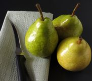 3 Pears. Along with a napkin and knife for slicing stock photos