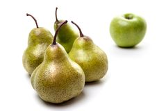 Pears and an apple on white. Pears and an apple isolated on white background Royalty Free Stock Images