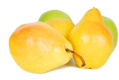 Pears and apples. Some yellow sweet pears and green apples isolated over white background Stock Photos