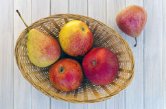 Pears and apples in a basket Royalty Free Stock Images