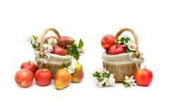 Pears and apples in a basket closeup on a white background Stock Photography