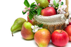 Pears and apples in a basket closeup on a white background Stock Photo