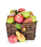 Pears and apples in basket Stock Images