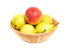 Pears and apples in a basket on a white background Stock Photo
