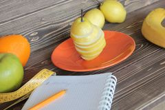 Pears, apples, oranges, bananas it is a correct feed. Pears, apples, oranges, bananas it is a correct feed, on a wooden table Stock Photo