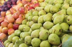 Pears, apples and plums on display at a farmer`s market. Fruit background. Healthy eating. Fall harvest agricultural Stock Photo