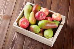 Pears and apples in wooden box Stock Photography