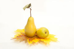 Pears with autumn leaves. Isolated on white Royalty Free Stock Images
