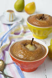 Pears baked in pastry with caramel peanut sauce Royalty Free Stock Image