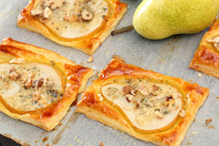 Pears baked in puff pastry with gorgonzola cheese and walnuts Royalty Free Stock Images
