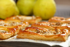 Pears baked in puff pastry with gorgonzola cheese and walnuts Stock Image