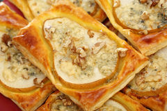 Pears baked in puff pastry with gorgonzola cheese and walnuts Stock Photo