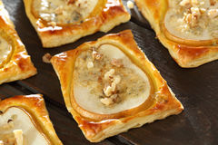 Pears baked in puff pastry with gorgonzola cheese and walnuts Royalty Free Stock Image