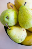 Pears and bananas. Fresh pears and bananas in a bowl Stock Photo