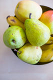 Pears and bananas. Fresh pears and bananas in a bowl Stock Image
