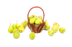 Pears in the basket and around the basket Stock Photos