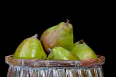 Pears in a basket isolated on a black background Stock Image