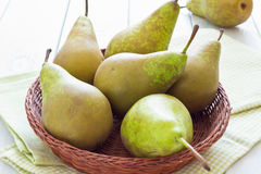 Pears in a basket. Large ripe pears in a basket on table Royalty Free Stock Images