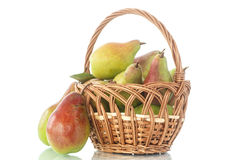 Pears in the basket. Ripe pears in a basket on a white background Royalty Free Stock Photos