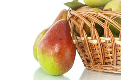 Pears in the basket. Ripe pears in a basket on a white background Stock Photography