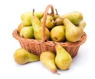 Pears in basket. Ripe pears in wicker basket. Pyrus communis Stock Photos