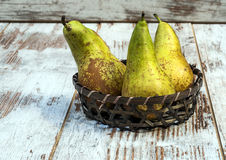 Pears in a basket Stock Images