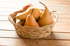 Pears in a basket Royalty Free Stock Photos