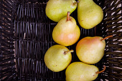 Pears in a black basket Stock Image