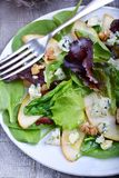 Pears and blue cheese salad. In plate Stock Photo