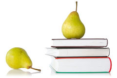 Pears and books Stock Photography