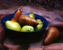 Pears in Bowl. Green and brown pears in blue bowl Stock Image