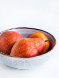 Pears in a bowl. On the board Stock Images