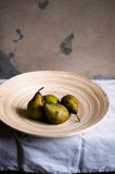 Pears in a bowl. A plate of pears on the table Stock Photography