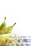 Pears in a bowl, white flowers, space for text Royalty Free Stock Images