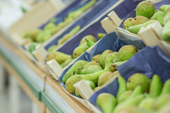 Pears in boxes in supermarket Royalty Free Stock Image