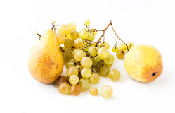 Pears and branches of ripe grapes Royalty Free Stock Image