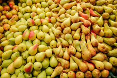 Pears bulk. Pears skin fruit food foreground healthy diet tail bulk green pear fresh sale district royalty free stock image