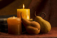 Pears candles and books Royalty Free Stock Photography