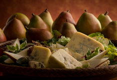 Pears and cheeses Stock Photography